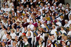 Small part of grand choir. Singing at Song and dance festival opening concert in Riga, Latvia, July 2008 Stock Images