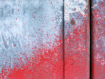 Small part of metal door sprinkled with red paint Royalty Free Stock Images