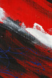 Small part of painted metal wall with  black,red,white paint and blue details Stock Image