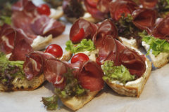 Small party sandwich with appetizer prosciutto and tomato Royalty Free Stock Image