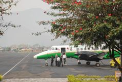 Small passenger airplane at the Pokhara airport early in the morning preparing to fly stock photo