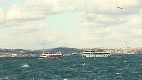Small passenger boat with the Turkish flag. Movement of boats in the Golden Horn. Small passenger boat with the Turkish flag stock video