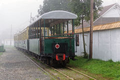 Small passenger carriages in the morning fog Stock Photos