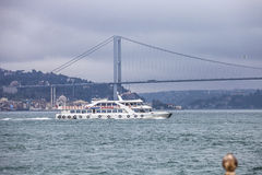 Small passenger ship  sailing in Bosphorus Strait. Royalty Free Stock Images