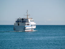 Small Passenger Ship in the SEA. Small passenger ship in sea rear view Stock Image