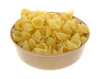 Small pasta shells in bowl Stock Photo