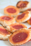 Small pastry pizzas. With tomato, blurred background Stock Photography
