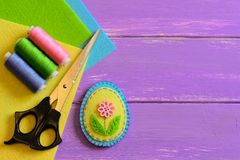 Small patchwork Easter egg decor, colored thread set, scissors, felt sheets on a purple wooden background with copy space. Easter crafts for kids. Fun DIY idea Stock Photography