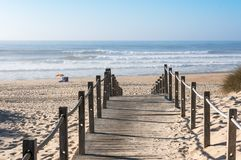 A small path leading through the sand to the ocean in Tocha stock photo