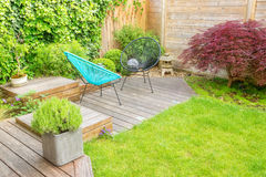 Small patio in a contemporary urban garden. Small modern patio in a contemporary urban garden Royalty Free Stock Photo