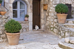 Small patio with flowers in the old village Gourdon Stock Image