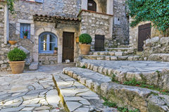 Small patio with flowers in the old village Gourdon Royalty Free Stock Photos