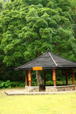 Small pavilion among nature with forest background Stock Photos