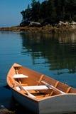 Small Peach Rowboat on Coast of Maine Royalty Free Stock Photos