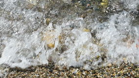 Small Pebble Beach. Footage of small waves on a pebble beach stock footage