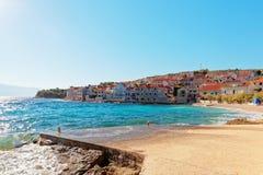 Small pebble beach of Postira town on Brac island - Croatia Stock Photos