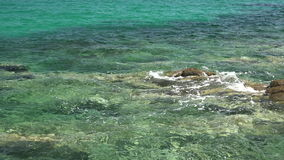 Small pebble beach with transparent water at the Corfu island, Greece stock video