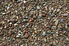 Pebbles on a Beach. Small pebbles of different sizes color and materials adorn a beach in Cambria California stock photos