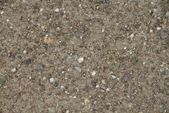 Small pebbles in dirt background Royalty Free Stock Photography