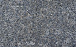 Small pebbles embedded in cement pavement,background. Small pebbles embedded in cement pavement Stock Image