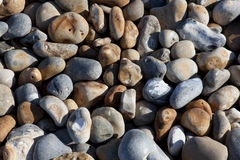 Small pebbles on Hastings beach. England stock photo