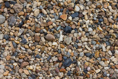 Small pebbles rock background Stock Photo