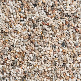 Small Pebbles Texture. Scattered pebbles as background in the morning light Stock Images