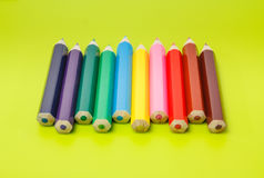 Small pencils side by side arranged by color Royalty Free Stock Photos