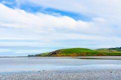 Small penninsula in Curio Bay, New Zealand. Small penninsula in Curio Bay, the Southern Scenic Route, New Zealand Royalty Free Stock Image