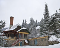 Small pension in the mountains. Picture of a small pension located in the Transylvanian mountains, in snowfall Stock Photography