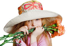 Small pensive girl with pink flowers. Small pensive girl in a big hat with pink flowers Royalty Free Stock Photos