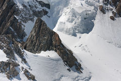 Small people. A group of climbers looks very small in a majestic mountain world Stock Images