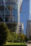 Small people and huge buildings on the High Line. NEW YORK CITY, USA, September 13, 2017 : The High Line also known as High Line Park is an elevated linear park Royalty Free Stock Photos