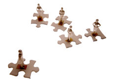 Small people on puzzle pieces  Stock Image