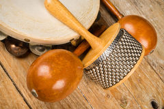 Small percussion instruments. Several small percussion instruments on a rustic wooden surface Stock Photo