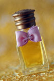 Small perfume with ribbon Royalty Free Stock Images