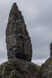 Small person in The Old Man of Storr, Skye. The Old Man of Storr, Skye, in Scotland Stock Photography