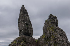 Small person in The Old Man of Storr, Skye. The Old Man of Storr, Skye, in Scotland Stock Photos