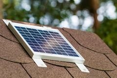 Small photovoltaic battery. On bower roof, alternative energy Stock Images