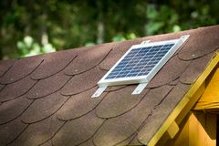 Small photovoltaic battery. On bower roof, alternative energy Stock Photography