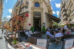 Small and picturesque street terraces with tourists, Bucharest, Stock Photo