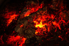 A small piece of burning and glowing wood. In a dying fire Royalty Free Stock Photos