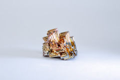 A small piece of natural bismuth on a white background Stock Photos