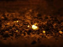 Small pieces of hot coal in the fireplace stock photo