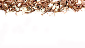 Small pieces of a milk chocolate on white background Stock Photography