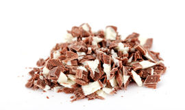 Small pieces of a milk chocolate on white background Royalty Free Stock Images