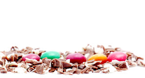 Small pieces of a milk chocolate on white background Stock Image