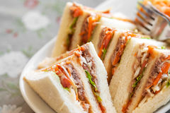 Small pieces Tuna Salad Sandwiches on table Royalty Free Stock Photography