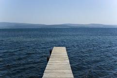 Small Pier. Endless seaside  seascape Royalty Free Stock Photos