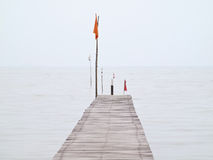 Small pier. Direction to sea in the mist stock photos
